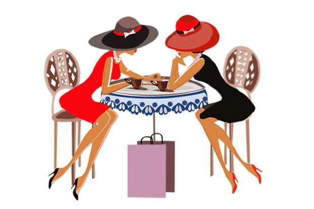 Две девушки за столиком в кафе